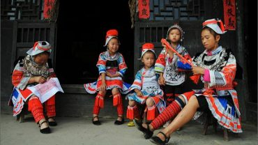 guizhou ethnic minorities of china kids playing