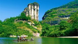 boat in front of Wuyi Mountain in china